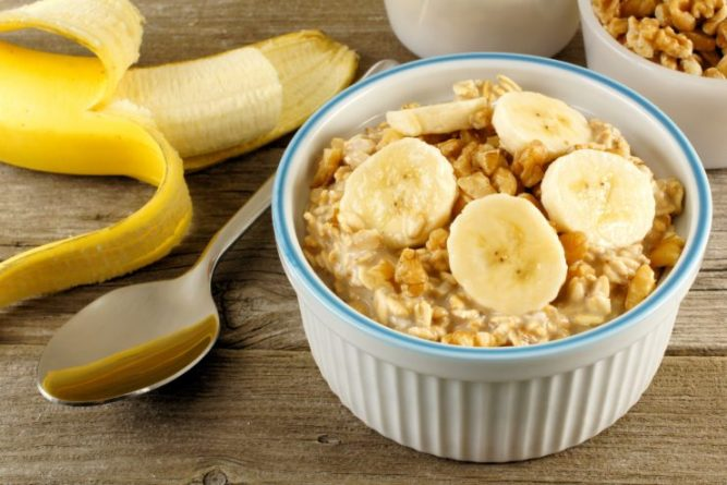 Banana walnut overnight oatmeal in a bowl on wood table